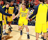 CHARLOTTESVILLE, VA- NOVEMBER 29:  Evan Smotrycz #23 of the Michigan Wolverines runs through the huddle before the game against the Virginia Cavaliers on November 29, 2011 at the John Paul Jones Arena in Charlottesville, Virginia. Virginia defeated Michigan 70-58. (Photo by Andrew Shurtleff/Getty Images) *** Local Caption *** Carlton Brundidge