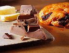 Chocolate pieces with a chocolate croissant. Food photos