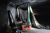 A makeshift migrant camp in a tunnel near the canal. El bordo. Tijuana, Mexico. Jan 07, 2015.