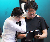 NEW YORK, NY-July 23:  Joon-ho Bong, Paul Dano shooting on location for Netflix & Plan B Enterainment  film Okja in New York. NY July 23, 2016. Credit:RW/MediaPunch