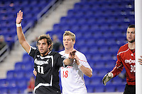 Giuseppe Guerriero (11) of the Providence Friars and Zach Patterson (18) of the Cincinnati Bearcats fight for position on a corner kick. The Providence Friars defeated the Cincinnati Bearcats 2-1 during the semi-finals of the Big East Men's Soccer Championship at Red Bull Arena in Harrison, NJ, on November 12, 2010.