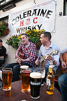Belfast, Northern Ireland, United Kingdom, May 2011. Traditonal music outside the pubs off hillstreet. A booming area for nightlife. For decades travellers stayed away from the sectarian violence, but since the end of'The Troubles' more and more people start discoving the beauty of Belfast and the Antrim Coast Causeway. Photo by Frits Meyst/Adventure4ever.com