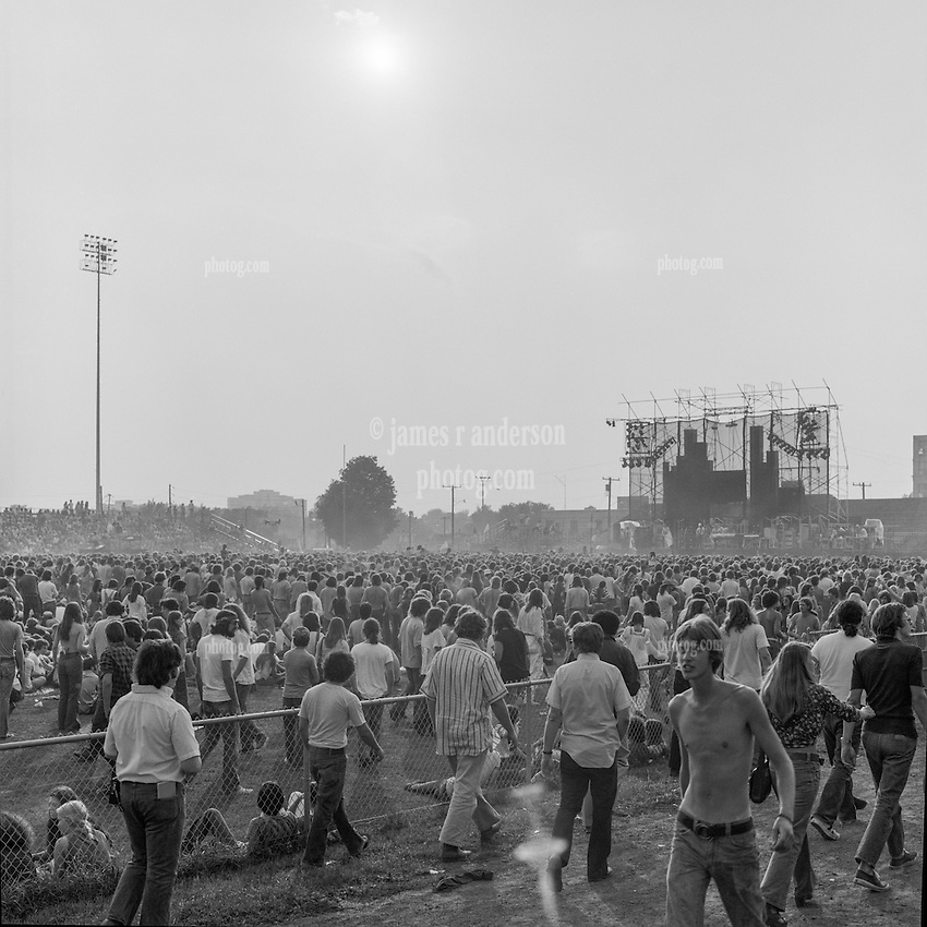 The Grateful Dead Concert at Dillon Stadium on 31 July 1974. B&W Original Film Scan. Photograph taken with a Hasselblad Camera with Tri-X film. View of the Stadium and Wall of Sound in distance.
