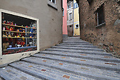 new steps to old very narrow cobble- stone street.