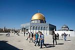 Palestinians walk at the al-Aqsa mosque compound following the Friday prayer in Jerusalem's old city on November 30, 2012. Photo by Mahfouz Abu Turk