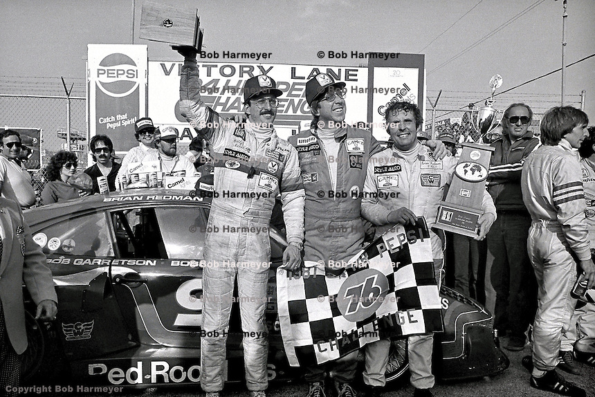 DAYTONA BEACH, FL - FEBRUARY 1: Bobby Rahal (left), Bob Garretson (center) and Brian Redman celebrate with the trophies in victory lane after winning the 24 Hours of Daytona on February 1, 1981, at the Daytona International Speedway in Daytona Beach, Florida.