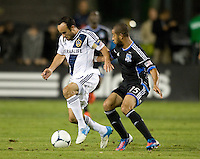 Landon Donovan of Galaxy dribbles the ball away from Justin Morrow of Earthquakes during the game at Buck Shaw Stadium in Santa Clara, California on November 7th, 2012.   LA Galaxy defeated San Jose Earthquakes, 3-1.