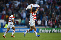 Kensuke Hatakeyama of Japan celebrates the win after the final whistle. Rugby World Cup Pool B match between South Africa and Japan on September 19, 2015 at the Brighton Community Stadium in Brighton, England. Photo by: Patrick Khachfe / Onside Images