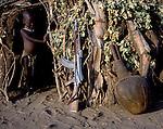 Turkana child and AK 47 Kalashnikov in a village in Turkana,   Northern Kenya