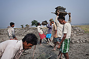 Day wage labourers from the Chowduli class work together to build an embankment for a fish field in Kuliadanga village of North 24 Parganas in West Bengal, India. Photo: Sanjit Das/Panos