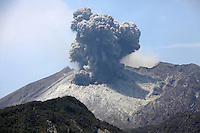 Sakurajima Volcano erupting, with ash cloud rising from Showa Crater of Japan's most active volcano. Fine ash is thrown up on flanks by impact of volcanic bombs, 2012.