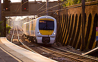 C2C Commuter Train coming into Pitsea Station, Basildon, Essex, Britain - May 2014.<br /> <br /> (scene of quite a few suicides from bridge)