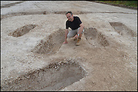 BNPS.co.uk (01202 558833) <br /> Pic: BournemouthUniversity/BNPS<br /> <br /> Dr Miles Russell at the site of the excavation.<br /> <br /> <br /> A group of first year university students have made one of the most significant archeological finds of recent times after discovering the 1,700-year-old remains of a wealthy Roman family.<br /> <br /> The budding archaeologists discovered a grave containing five super-rich Romans in a farmer's field in rural Dorset just metres from where a 4th century villa was found.<br /> <br /> Although more than 700 Roman villas have been found in Britain, it is the first time ever the people who lived in them have been uncovered.<br /> <br /> Experts have described the find as &quot;hugely significant&quot; - and say it could provide vital clues to who was living in Britain around 350 AD.<br /> <br /> Around 85 students, mostly aged in their late teens and early 20s, made the landmark discovery after carrying out a study on a corn field near Winterbourne Kingston near Blandford in Dorset.