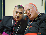 Archbishop Bashar Matti Warda (left) translates for Cardinal Timothy Dolan, the archbishop of new York, suring a conversation with students at St. Peter's Seminary in Ankawa, Iraq, on April 9, 2016. Dolan, chair of the Catholic Near East Welfare Association, is in Iraqi Kurdistan with other church leaders to visit with Christians and others displaced by ISIS. Warda heads the Chaldean Catholic Archdiocese of Erbil, and has been a staunch champion for displaced Christians and others living in his archdiocese.