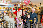 Santa arrived at Garvey's SuperValu, Food & Wine Fair on Tuesday. Pictured here with Mary Foley, Orla Foley, Cabhan Foley, Johnny Foley,  Mia  Janako