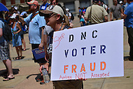 """Philadelphia, PA - July 26, 2016: A woman displays a sign denouncing a recent email scandal at the Democratic National Committee at a """"Bernie or Bust"""" rally across from City Hall during the Democratic National Convention in Philadelphia, PA, July 26, 2016  (Photo by Don Baxter/Media Images International)"""