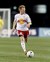 New York Red Bulls midfielder Dax McCarty (11) looks to pass. Despite a red-card man advantage, in a Major League Soccer (MLS) match, the New England Revolution tied New York Red Bulls, 1-1, at Gillette Stadium on September 22, 2012.