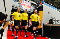 The officiating crew of Alan Kelly, Caleb Mendez, Dimitar Chadarav, and Marc Lawrence lead the players onto the field prior to the start of the match. The New York Red Bulls and the Colorado Rapids played to a 1-1 tie during a Major League Soccer (MLS) match at Red Bull Arena in Harrison, NJ, on March 15, 2014.