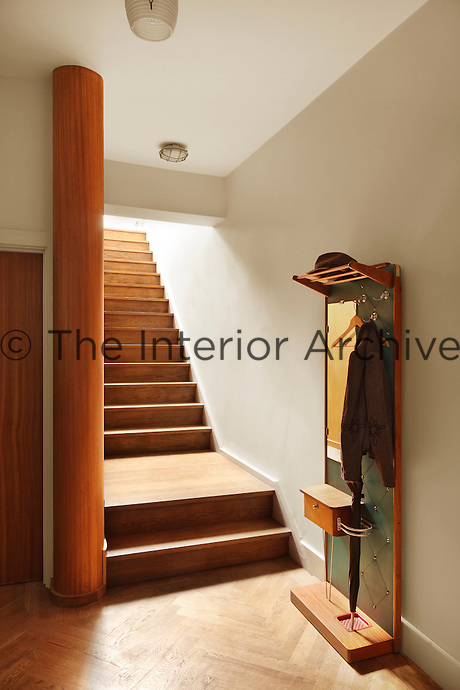 The use of beautiful wood in the entrance hall gives the space a warm, inviting quality.