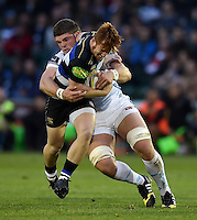 Rory Jennings of Bath Rugby is tackled by Dave Ewers of Exeter Chiefs. West Country Challenge Cup match, between Bath Rugby and Exeter Chiefs on October 10, 2015 at the Recreation Ground in Bath, England. Photo by: Patrick Khachfe / Onside Images