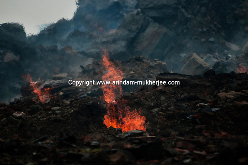 A mine fire surfacing the grounds at Laltenganj, Jharia. A huge coal mine fire is engulfing the city of Jharia from all its sides. All scientific efforts have gone in vain to stop this raging fire. This fire is affecting lives of people living in and around Jharia. Jharkhand, India. Arindam Mukherjee