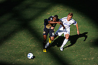 Danny Mwanga (10) of the Philadelphia Union and Jimmy Conrad (12) of the Kansas City Wizards battle for the ball. The Philadelphia Union and the Kansas City Wizards played to a 1-1 tie during a Major League Soccer (MLS) match at PPL Park in Chester, PA, on September 04, 2010.