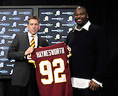 Ashburn, VA - February 27, 2009 -- Washington Redskins Head Coach Jim Zorn, left, holds the jersey of his newest player, Albert Haynesworth, a 6 foot, 6 inch, 320 pound defensive tackle formerly with the Tennessee Titans, after their meeting with reporters at Redskins Park in Ashburn, Virginia after signing a 100 million dollar contract with the Washington Redskins on Friday, February 27, 2009.  Since he came into the NFL in 2002, Haynesworth has posted 271 tackles (199 solo) and 24 quarterback sacks.  He was elected to the Pro Bowl following the 2007 and 2008 seasons..Credit: Ron Sachs / CNP