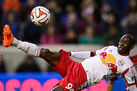 Bradley Wright-Phillips (99) of the New York Red Bulls attempts a bicycle kick. The New York Red Bulls and Chivas USA played to a 1-1 tie during a Major League Soccer (MLS) match at Red Bull Arena in Harrison, NJ, on March 30, 2014.