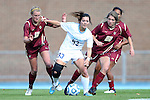 03 November 2013: North Carolina's Brooke Elby (93) is challenged by Boston College's Jana Jeffrey (12) and McKenzie Meehan (22). The University of North Carolina Tar Heels hosted the Boston College Eagles at Fetzer Field in Chapel Hill, NC in a 2013 NCAA Division I Women's Soccer match and the quarterfinals of the Atlantic Coast Conference tournament. North Carolina won the game 1-0.