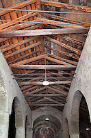 View from below of the ceiling of Santa Maria de Taull Church, 1123, consecrated by Ramon Guillem, the bishop of Roda, Taull, Province of Lleida, Catalonia, Spain. The roof, of two sheds, is built of wood. The cylindrical columns separating the nave from its aisles have no capitals. The church was heavily renovated in the 18th century. Its frescoes were removed to the MNAC (National Art Museum of Catalonia, Barcelona) circa 1918. Santa Maria de Taull Church is part of the Catalan Romanesque churches of the Vall de Boí which were declared a World Heritage Site by UNESCO in November 2000. Picture by Manuel Cohen