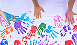 People make hand prints on a banner at the CROP Hunger Walk, held October 27, 2013, in Raleigh, North Carolina.