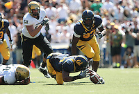 Mychal Kendricks gets the fumble recovery. The California Golden Bears defeated the Colorado Buffaloes 52-7 at Memorial Stadium in Berkeley, California on September 11th, 2010.
