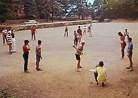 Saint John Villa Academy, NY, Students playing baseball on a dirt field