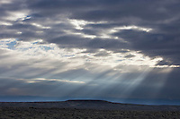 Sunbeams falling on the Bighorn Basin with the Bighorn Mountains in the distance