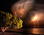 Lightning off the coast of Shell Point, in Wakulla County south of Tallahassee, Florida July 21, 2007.    (Mark Wallheiser/TallahasseeStock.com)