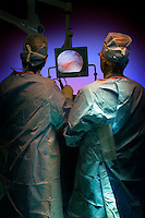 Two Orthopedic surgeons doing arthroscopic surgery in the OR