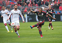 Toronto, Ontario - May 3, 2014: Toronto FC forward Jermain Defoe #18 and New England Revolution midfielder/forward Lee Nguyen #24 in action during a game between the New England Revolution and Toronto FC at BMO Field.