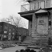 "East Cleveland, Ohio.March 25, 2008 ..In East Cleveland there are streets in which every home is boarded up and abandon after foreclosure and eviction. Junkies, drug dealers, squatters and the homeless are known to inhabit these buildings and the area has become extremely dangerous. Some residents refer to it as ""Mad Max"" and claim that anything can be purchased here: children, drugs, women...Murder is also very common in this district."
