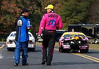 Oct 6, 2013; Mohnton, PA, USA; NHRA pro stock winner Jeg Coughlin Jr (right) talks with runner up Allen Johnson following the Auto Plus Nationals at Maple Grove Raceway. Mandatory Credit: Mark J. Rebilas-