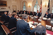 United States President George H.W. Bush meets with the National Security Council regarding Iraq's invasion of Kuwait. Participants are: Henson Moore, Deputy Secretary of Energy; William Webster, Director of the Central Intelligence Agency (CIA); U.S. Secretary of State James A.  Baker, III; Donald Atwood, Deputy Secretary of Defense; Richard Darman, Director, Office of Management and Budget (OMB); White House Chief of Staff John Sununu (not pictured);  Michael Boskin, Chairman, Council of Economic Advisors (not pictured); U.S. Attorney General Richard Thornburgh; U.S. Secretary of the Treasury Nicolas Brady; U.S. Vice President Dan Quayle, National Security Advisor General Brent Scowcroft; and General Colin Powell, Chairman, Joint Chiefs of Staff in the Cabinet Room of the White House in Washington, D.C. on August 6, 1990.<br />