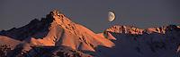 Moonrise behind Matanuska Peak and the Chugach mountains at sunset.