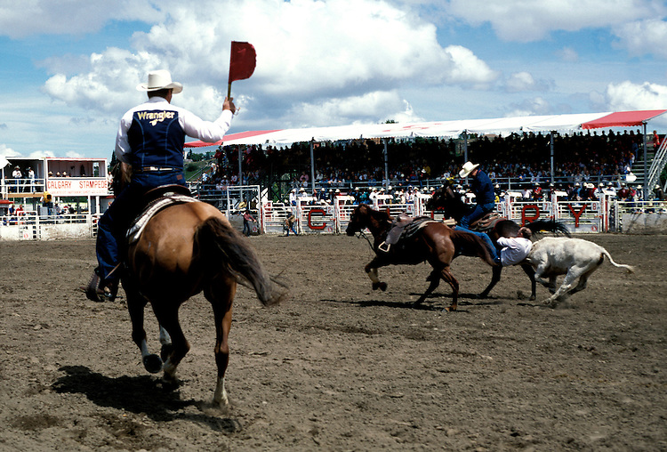 Canada: The Canadian Rockies.  Roping event at the Calgary Stampede.  Photo #: cnrock102..Photo copyright Lee Foster, 510/549-2202, lee@fostertravel.com, www.fostertravel.com.