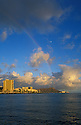 Diamond Head and Waikiki hotels with rainbow and moon; Honolulu, Oahu, Hawaii.
