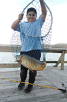 Courtesy photo<br /> David Rojas, 8, shows a Lake Fayetteville carp he caught last winter. David and his dad, Jorge Rojas, fish for carp most every Sunday at the lake.