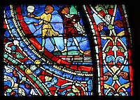 Servants carry drinks to the Reunion Feast, from the Parable of the Prodigal Son stained glass window, in the north transept of Chartres Cathedral, Eure-et-Loir, France. This window follows the parable as told by St Luke in his gospel. It is thought to have been donated by courtesans, who feature in 11 of the 30 sections. Chartres cathedral was built 1194-1250 and is a fine example of Gothic architecture. Most of its windows date from 1205-40 although a few earlier 12th century examples are also intact. It was declared a UNESCO World Heritage Site in 1979. Picture by Manuel Cohen