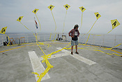 LUTZ TRECZOCKS WITH HIS YELLOW &quot;STOP PLUTONIUM&quot; KITE, MVAS, JAPAN. 030702. .PIC &copy; JEREMY SUTTON-HIBBERT/GREENPEACE 2002..*****ALL RIGHTS RESERVED. RIGHTS FOR ONWARD TRANSMISSION OF ANY IMAGE OR FILE IS NOT GRANTED OR IMPLIED. CHANGING COPYRIGHT INFORMATION IS ILLEGAL AS SPECIFIED IN THE COPYRIGHT, DESIGN AND PATENTS ACT 1988. THE ARTIST HAS ASSERTED HIS MORAL RIGHTS. *******