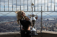 """New York, USA. 23 April 2014.  """"Miss Supercross"""" Dianna Dahlgren, holds up the trophy as she promotes the motorcycle race during a visit to the Empire State Building in New York. Photo by Eduardo Munoz Alvarez/VIEWpress"""