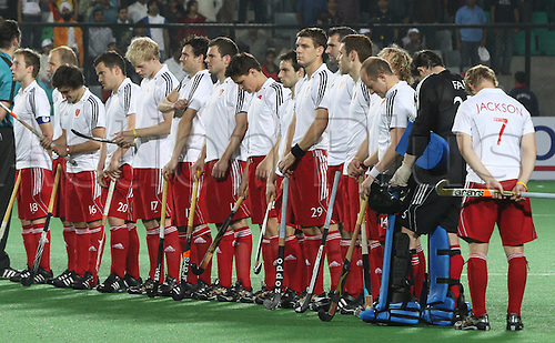 28.02.2010.Delhi,India.FIH World Cup Field Hockey.Australia verses England.Englandís hockey players line up for the national anthem during their match against Australia at the men's Hockey World Cup in New Delhi. Photo: Pankaj Nangia/Actionplus - Editorial Use