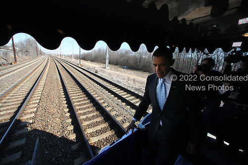 Claymont, DE - January 17, 2009 -- United States President-Elect Barack Obama during the first slow roll at Myrtle and Marion Avenues, Claymont, Delaware, on the way to Wilmington, Delaware, during the Whistle Stop tour on Saturday, January 17, 2009..Credit: Chang W. Lee - Pool via CNP