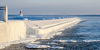 The Presque Isle breakwall with a thick coating of ice and steam rising from Lake Superior. Marquette, MI